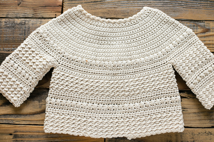 Back view of crochet sweater for kids.