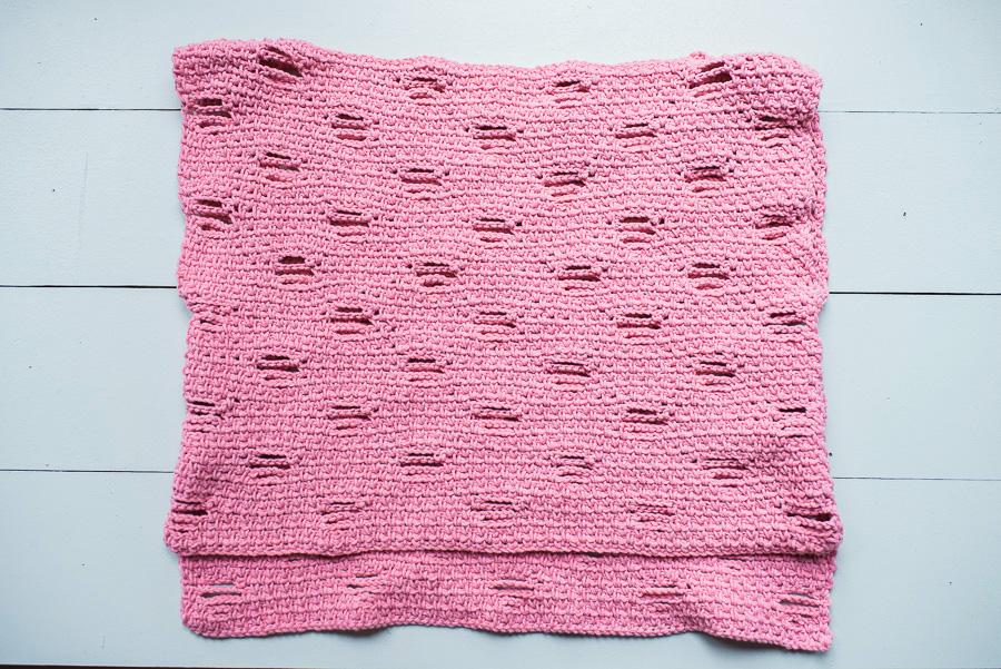 Crochet top laid flat.