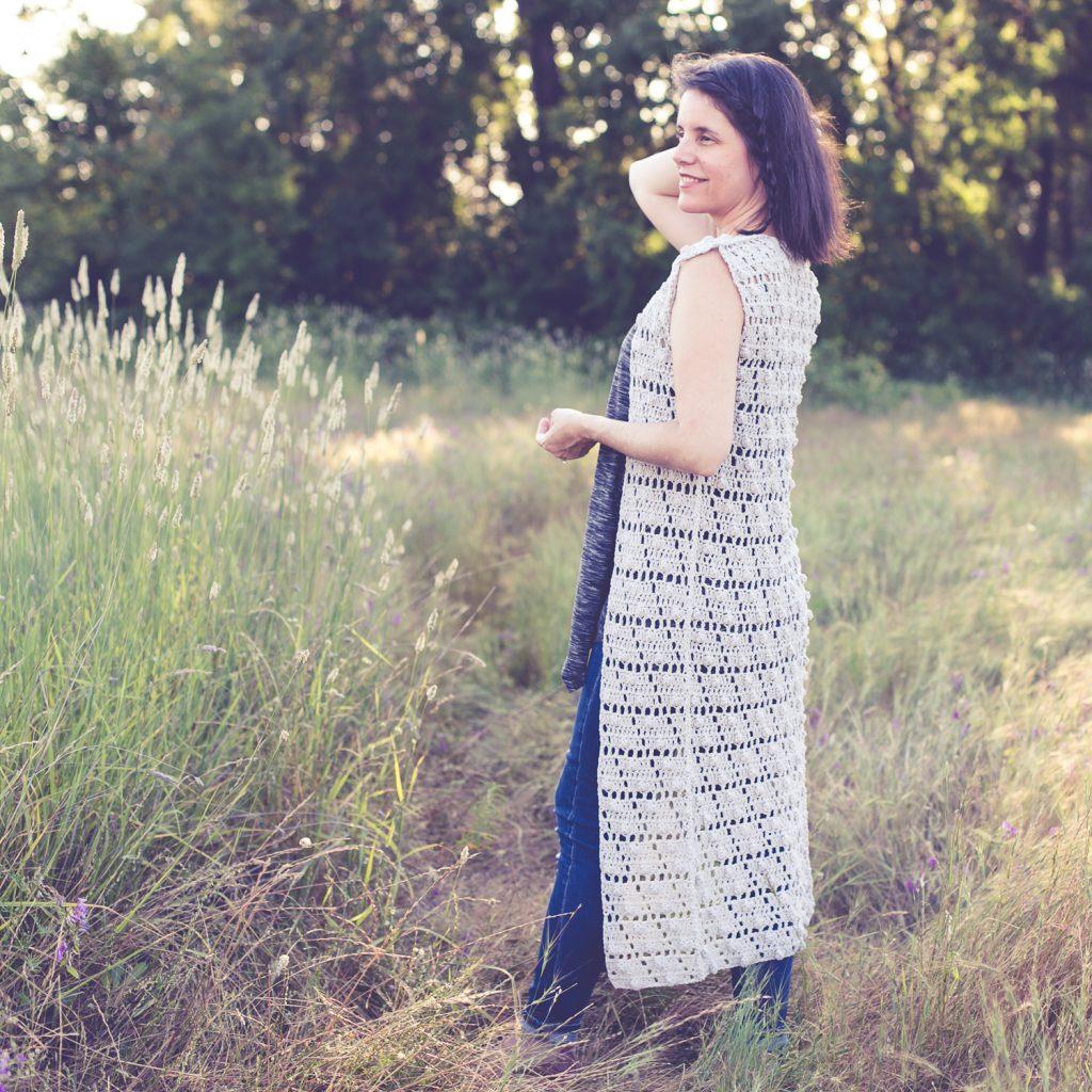 Woman wearing free crochet pattern for long summer vest.