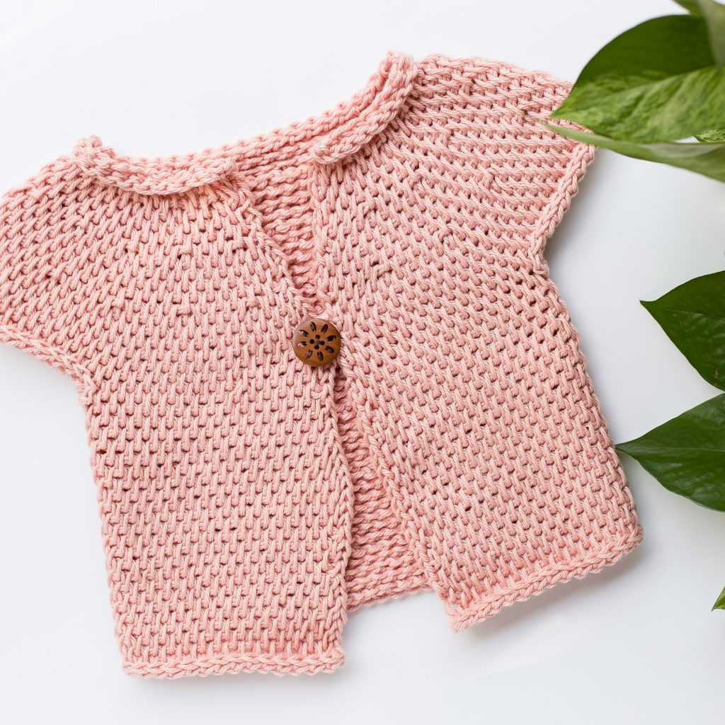Short sleeve tunisian crochet baby sweater pattern.