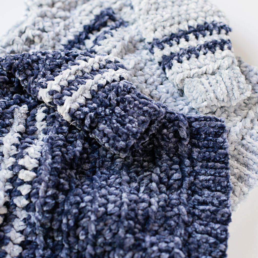 Sleeve detail of two velvet crochet sweaters.