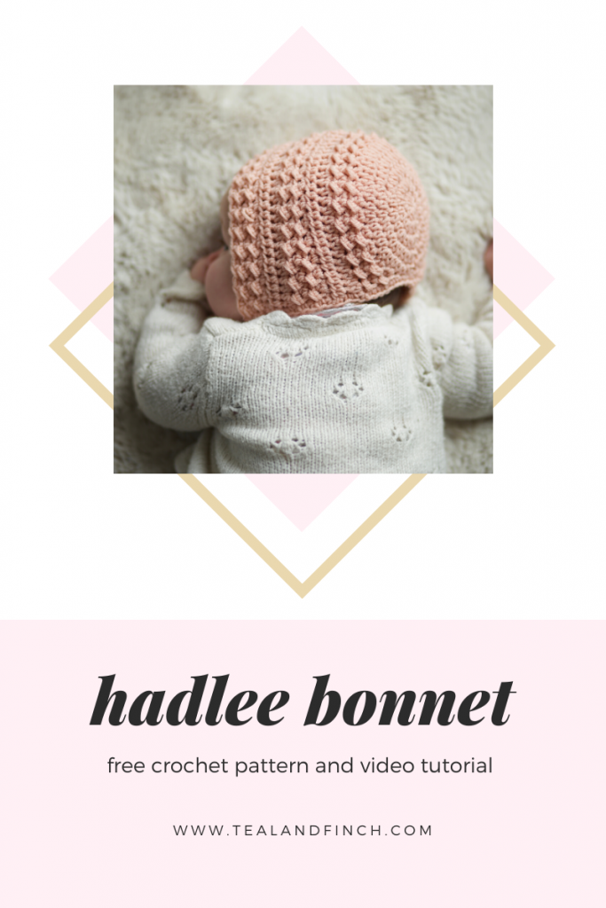 baby wearing a crochet bonnet